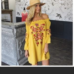 Yellow off the shoulder embroidered Dress. Size
